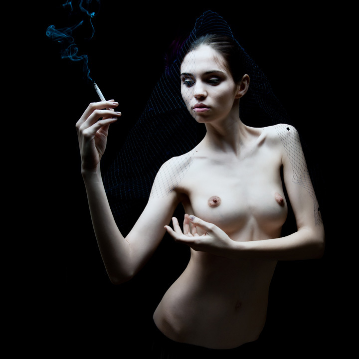 Smoking dressed the naked woman • Marc Lamey