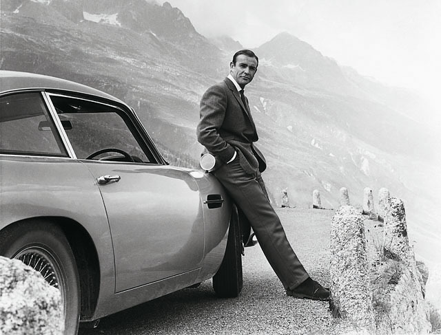 James Bond (Sean Connery) and his iconic Aston Martin DB5, filming Goldfinger (1964) at the Furka Pass, Switzerland.  James Bond films © 1962-2012 Danjaq, LLC and United Artists Corporation. All rights reserved