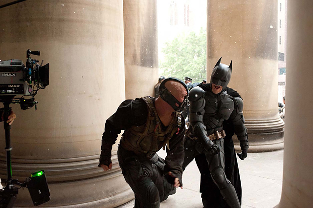 Batman (Christian Bale) throws a powerful blow at Bane (Tom Hardy) during principal photography in Pittsburgh. © Warner Bros. Entertainment Inc