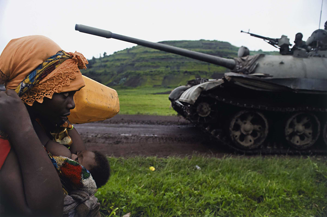 War / Photography: Images of Armed Conflict and Its Aftermath by Anne Wilkes Tucker, Will Michels and Natalie Zest (Yale University Press) - Walter Astrada, Argentinean, born 1974, Congolese women fleeing to Goma, from the series Violence against women in Congo, Rape as weapon of war in DRC, 2008, Chromogenic print, The Museum of Fine Arts, Houston, museum purchase with funds provided by Photo Forum 2010 © Walter Astrada